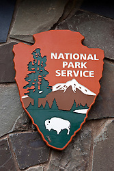National Park Service logo shield on a rock wall, Grand Portage National Monument, Grand Portage, Minnesota, United States of America