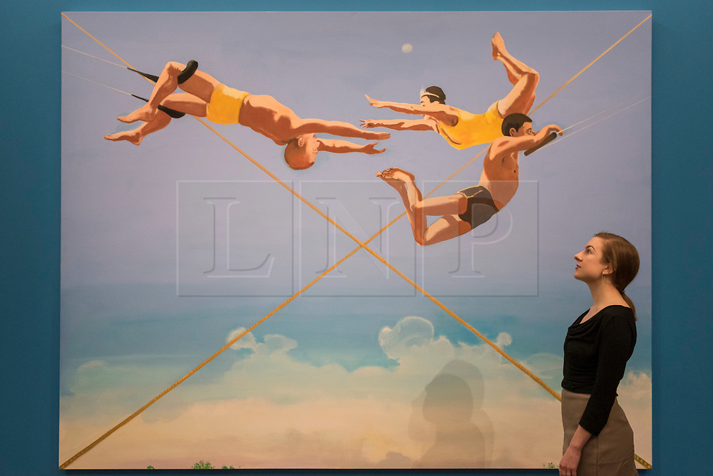 "© Licensed to London News Pictures. 08/09/2017. London, UK. A staff member views ""Three Aerialists"", 2004, by Verne Dawson (Est. GBP50-70k), at a preview of 'Shake It Up', a collection of contemporary artworks from the personal collection of celebrity photographer Mario Testino. Proceeds from the upcoming auction of the collection at Sotheby's in London will benefit Museo Mate in Lima, Peru.  Photo credit : Stephen Chung/LNP"