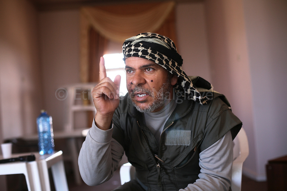 Libyan rebel commander Salahadin Badi during an interview with a reporter in a house behind Misrata's southern front of Abdel Raouf. A two days ago, a grenade explosion injured his face. 12 June 2011.