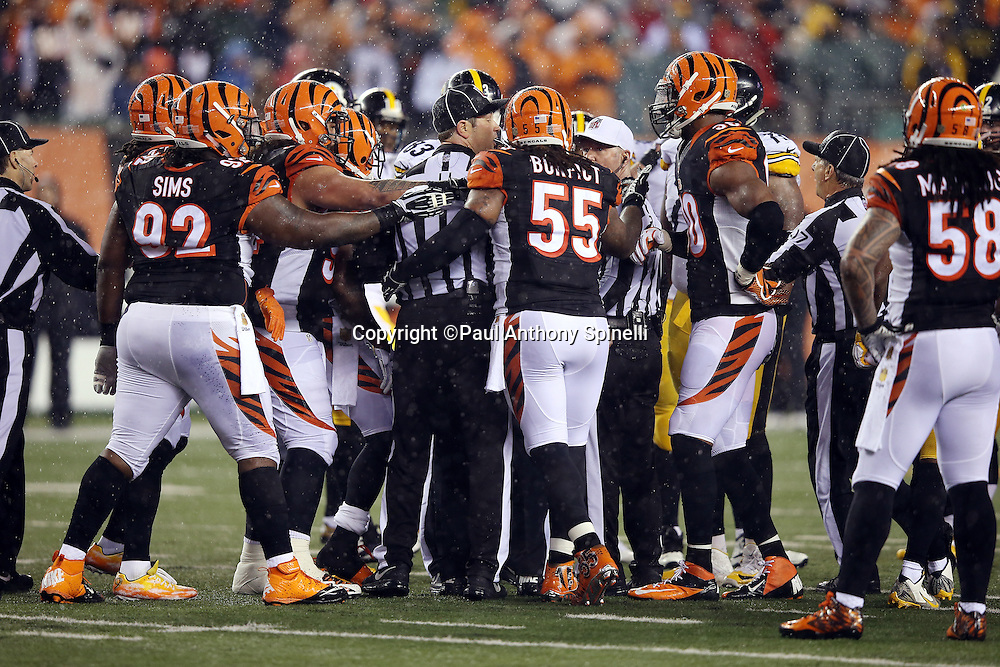 Cincinnati Bengals outside linebacker Vontaze Burfict (55) is in the middle of the action during a melee that NFL officials are trying to get under control during the NFL AFC Wild Card playoff football game against the Pittsburgh Steelers on Saturday, Jan. 9, 2016 in Cincinnati. The Steelers won the game 18-16. (©Paul Anthony Spinelli)