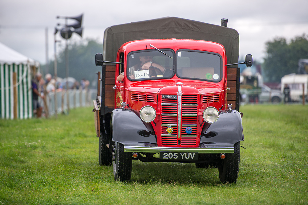 Mature male drives vintage vehicle that is used for cattle removal and other agriculture services, Masham, North Yorkshire, UK