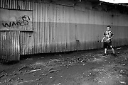 ........ Plays ball with his friends in the slum of San Felipe.