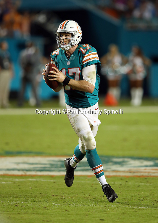 Miami Dolphins quarterback Ryan Tannehill (17) rolls out as he looks to throw during the NFL week 14 regular season football game against the New York Giants on Monday, Dec. 14, 2015 in Miami Gardens, Fla. The Giants won the game 31-24. (©Paul Anthony Spinelli)
