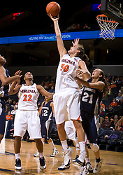 Virginia forward Chelsea Shine (50) grabs a rebound from Monmouth forward Jennifer Bender (21).  The Virginia Cavaliers women's basketball team defeated the Monmouth Hawks 71-45 at the John Paul Jones Arena in Charlottesville, VA on December 18, 2008.