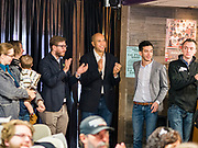 20 DECEMBER 2019 - ADEL, IOWA: US Senator CORY BOOKER (D-NJ), center, waits to speak at a campaign stop in the Adel Family Fun Center, a bowling alley in Adel. Sen Booker is on a bus tour across Iowa to support his candidacy for the US Presidency. Iowa traditionally holds the first event of the presidential election cycle. The Iowa caucuses are Feb. 3, 2020.       PHOTO BY JACK KURTZ