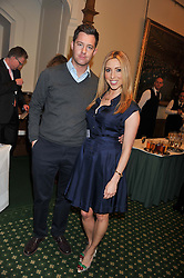 PHILIP TAYLOR and KATE WALSH at a reception for The Mirela Fund in partnership with Hope and Homes for Children hosted by Natalie Pinkham in The Churchill Room, House of Commons, London on 30th April 2013.