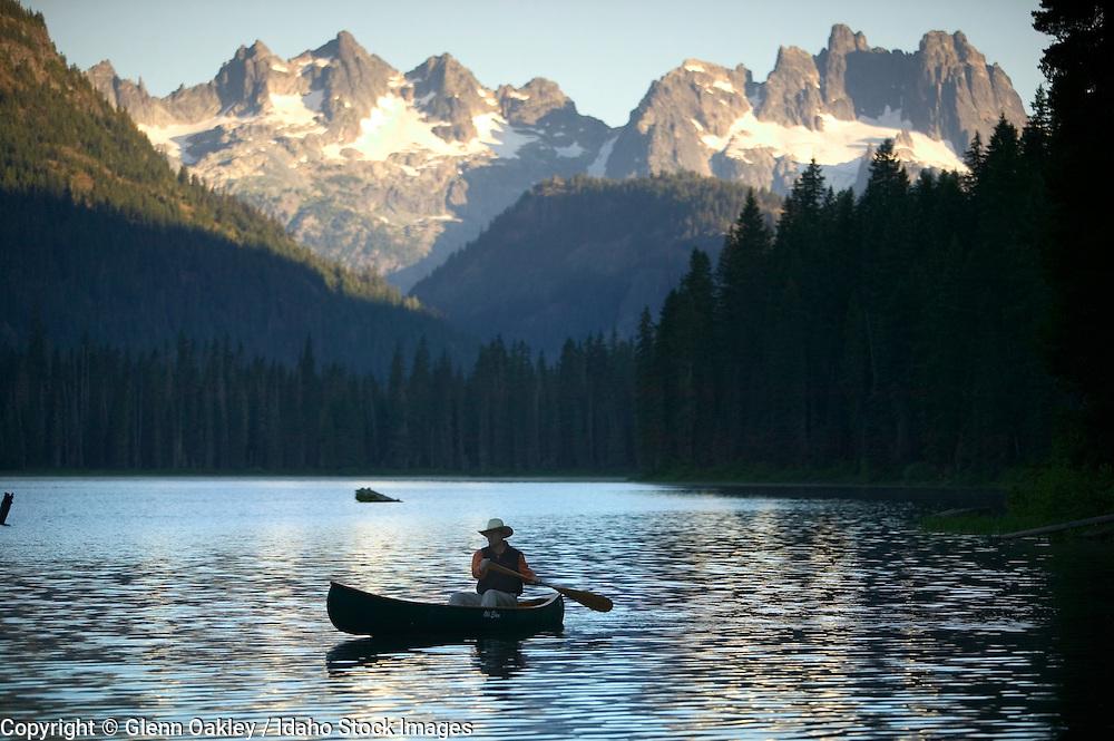 Idaho. Canoe on Redfish Lake in the Sawtooth Mountains.