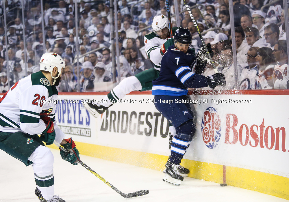 WINNIPEG, MB – April 11: Winnipeg Jets defenseman Ben Chiarot (7) is bodied by Minnesota Wild forward Marcus Foligno (17) during the Stanley Cup Playoffs First Round Game 1 between the Winnipeg Jets and the Minnesota Wild on April 11, 2018 at the Bell MTS Place in Winnipeg MB. (Photo by Terrence Lee/Icon Sportswire)