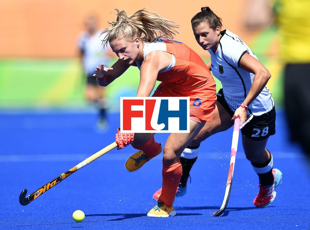 Netherlands' Laurien Leurink (L) and Germany's Julia Muller vie during the women's field hockey Netherlands vs Germany match of the Rio 2016 Olympics Games at the Olympic Hockey Centre in Rio de Janeiro on August, 13 2016. / AFP / MANAN VATSYAYANA        (Photo credit should read MANAN VATSYAYANA/AFP/Getty Images)