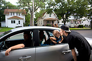 "Tatum Brown, 2, kisses his father David Brown goodbye as he goes to work at Josie's Party Store on Thursday, July 23, 2015, in Jackson, Michigan. Name Your Fare driver Matt Wilcox, left, took Tatum and his mother Jessica to the movies afterward. David said his family doesn't have a car and often uses Name Your Fare to get to work. ""They really help us out a lot,"" he said. Name Your Fare is a transportation company offering rides to Jackson costumers at a rate of their choosing. (Nick Gonzales 