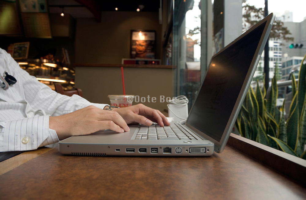 business man working on his laptop in a coffee bar