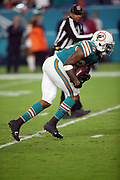 Miami Dolphins cornerback Xavien Howard (25) intercepts a third quarter pass intended for New England Patriots wide receiver Brandin Cooks (14) and returns it 29 yards to the Patriots 46 yard line during the 2017 NFL week 14 regular season football game against the New England Patriots, Monday, Dec. 11, 2017 in Miami Gardens, Fla. The Dolphins won the game 27-20. (©Paul Anthony Spinelli)