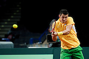 Bernard Tomic from Australia in action during the BNP Paribas Davis Cup 2013 between Poland and Australia at Torwar Hall in Warsaw on September 15, 2013.<br /> <br /> Poland, Warsaw, September 15, 2013<br /> <br /> Picture also available in RAW (NEF) or TIFF format on special request.<br /> <br /> For editorial use only. Any commercial or promotional use requires permission.<br /> <br /> Photo by &copy; Adam Nurkiewicz / Mediasport