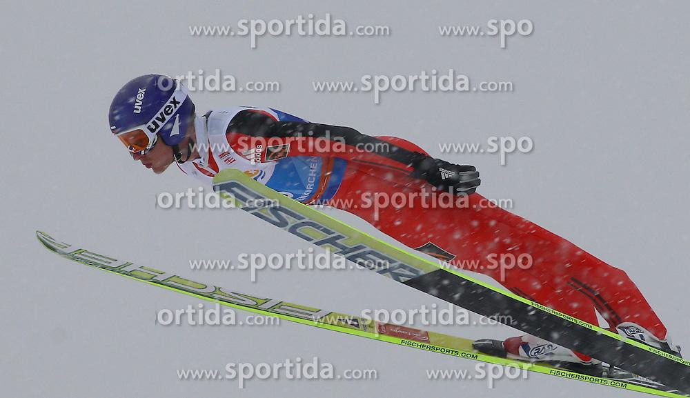 31.12.2011, Olympia Skisprungschanze, Garmisch Partenkirchen, GER, 60. Vierschanzentournee, FIS Ski Sprung Weltcup, Training, im Bild Denis KORNILOV (RUS) // Denis KORNILOV (RUS) during a practice session of 60th Four-Hills-Tournament FIS World Cup Ski Jumping at Olympia Skisprungschanze, Garmisch Partenkirchen, Germany on 2011/12/31. EXPA Pictures © 2011, PhotoCredit: EXPA/ Sven Kiesewetter