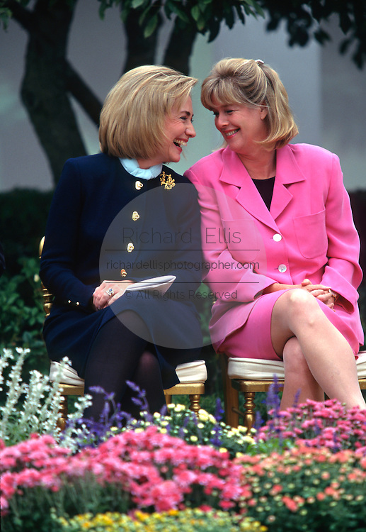 US first lady Hillary Clinton shares a laugh with Tipper Gore during an event at the White House March 22, 1997 in Washington, DC.