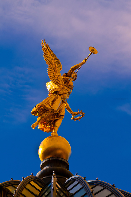 "Statue of an angel holding the ""Trumpet of Fame"" atop the Kunstakademie (Art Academy), Dresden, Saxony, Germany"