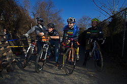 "Philadelphia, PA, USA - December 21, 2014; Each year a group cycling enthusiasts converge on a junkyard in North Philadelphia to race each other on dirt paths winding between junk cars at the annual Bilenky Cyclocross event.<br /> <br /> Participants race on all sorts of bikes, including homemade ""funnies,"" over a course that takes them under, over and around vehicles parked on the junkyard. The venue is between the railroad tracks and the bicycle factory of Bilenky Cycle Works in North Philadelphia.<br /> <br /> For a recap of the event check the photo-essay I made on assignment for WHYY's Viewfinders' blog on NewsWorks.org:<br />  http://www.newsworks.org/index.php/viewfinders/item/76577-bicycle-racers-take-on-a-north-philly-junkyard"