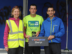 Colette Sweeney and Paul Feeney making the presentation to James Dolan Lecarrow, Roscommon who was the winner of  Westport Leisure Park's 'Last Man Running' on saturday last.<br /> Pic Conor McKeown