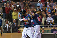 Aaron Hicks #32 and Pedro Florimon #25 of the Minnesota Twins celebrate after Hicks hit his 2nd home run of the game against the Chicago White Sox on May 13, 2013 at Target Field in Minneapolis, Minnesota.  The Twins defeated the White Sox 10 to 3.  Photo: Ben Krause