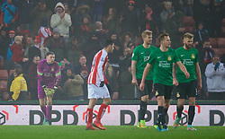 STOKE-ON-TRENT, ENGLAND - Sunday, January 4, 2015: Wrexham's goalkeeper Jonathan Flatt looks dejected as Stoke City score the third goal during the FA Cup 3rd Round match at the Britannia Stadium. (Pic by David Rawcliffe/Propaganda)