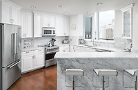 A friend and colleague designed this stunning white kitchen in a penthouse condo on Harbour Island in Tampa, Florida. This kitchen was photographed as both real estate photography and interiors photography, for an agent and designer's portfolio.
