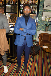 TINIE TEMPAH at a cocktail reception hosted by the Woolmark Company, Pierre Lagrange and the Savile Row Bespoke Association to celebrate 'The Ambassador's Project' for London Collections Mens at Marks Club, Charles street, London on 8th January 2016.