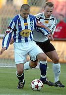 n/z.: Rafal Lasocki (nr3-Lech) , Bartosz Karwan (nr14-Legia) podczas meczu ligowego Legia Warszawa (biale) - Lech Poznan (niebieskie-biale) 3:0 , I liga polska , 21 kolejka sezon 2004/2005 , pilka nozna , Polska , Warszawa , 07-05-2005 , fot.: Adam Nurkiewicz / mediasport..Rafal Lasocki (nr3-Lech) , Bartosz Karwan (nr14-Legia) fight or the ball during Polish league first division soccer match in Warsaw. May 07, 2005 ; Legia Warsaw (white) - Lech Poznan (blue-white) 3:0 ; first division , 21 round season 2004/2005 , football , Poland , Warsaw ( Photo by Adam Nurkiewicz / mediasport )
