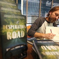 Adam Robison   BUY AT PHOTOS.DJOURNAL.COM<br /> Author Michael Farris Smith signs books at Reed's Gum Tree Bookstore in Tupelo on Tuesday.