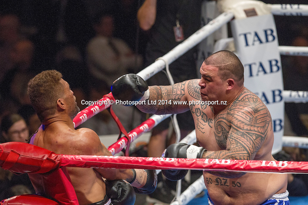 Dave (Brown Buttabean) Letele, right,  fights Lopini (MVPHorse) Vatuvei at the Hydr8 Zero Heavyweight Explosion, Vodafone Events Centre, Auckland, New Zealand, Saturday, July 05, 2014. Photo: David Rowland/Photosport