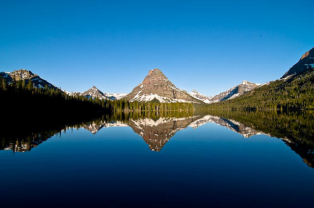 calm spring day glacier national park, sinopah mountain, crown of the continent, montana, usa