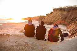 Watching sunset on Lucy Vincent Beach, Martha's Vineyard, Massacheutts, USA. 06/12/15. Photo by Andrew Tallon