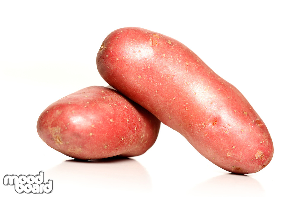 Red potaoes on white background