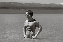 man with a great body standing in a lake