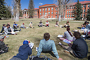 Students attend a Marketing class on Taylor Lawn during a sunny, spring afternoon.