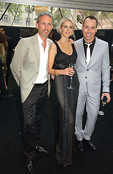 Left to right, PATRICK COX, DONNA AIR and DAVID FURNISH at the 2006 Glamour Women of the Year Awards 2006 held in Berkeley Square Gardens, London W1 on 6th June 2006.<br />