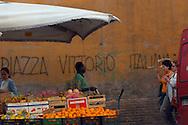 Roma, 24/05/2005: Piazza Vittorio, immigrati e scritta razzista.