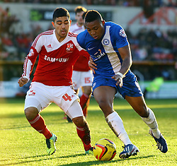 Peterborough United's Britt Assombalonga in action with Swindon Town's Massimo Luongo - Photo mandatory by-line: Joe Dent/JMP - Tel: Mobile: 07966 386802 11/01/2014 - SPORT - FOOTBALL - County Ground - Swindon - Swindon Town v Peterborough United - Sky Bet League One