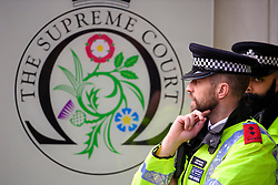 © Licensed to London News Pictures. 07/12/2016. London, UK. Police stand at the entrance to the Supreme Court in Westminster, London on day three of a hearing to appeal against a November 3 High Court ruling that Article 50 cannot be triggered without a vote in Parliament. Photo credit: Ben Cawthra/LNP