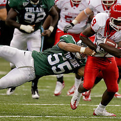 Oct 17, 2009; New Orleans, LA, USA; Houston Cougars wide receiver James Cleveland (19) breaks away from the tackle by Tulane Green Wave linebacker David Kirksey (55) at the Louisiana Superdome. Houston defeated Tulane 44-16. Mandatory Credit: Derick E. Hingle-US PRESSWIRE