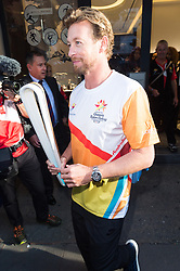 August 16, 2017 - London, London, UK - London, UK. Longines Ambassador of Elegance Simon Baker runs with The 2018 Commonwealth Games QueenÃ•s Baton at the Longines Botique in London. The Queen's Baton Relay began its journey in Buckingham Palace earlier this year and is now travelling through 71 nations or territories of the Commonwealth, covering 230'000 kilometres. (Credit Image: © Ray Tang/London News Pictures via ZUMA Wire)