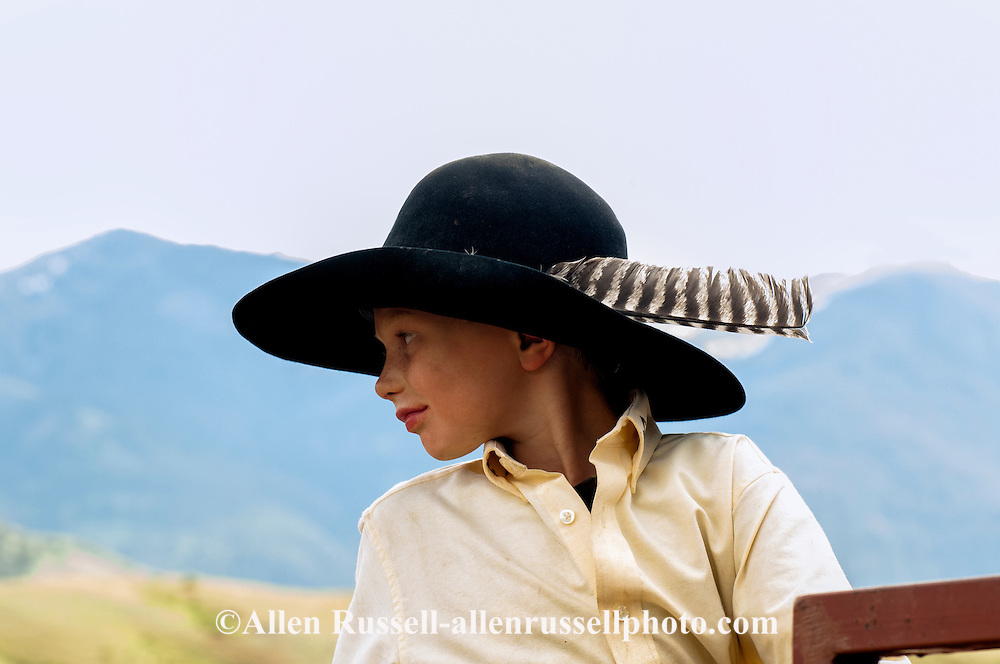 Young Cowboy With Feather In Cowboy Hat Allen Russell