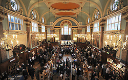 ©London News pictures...04/11/2010. The main hall. Chelsea Antiquarian Book Fair. The 20th annual Chelsea Antiquarian Book Fair takes place at Old Chelsea Town Hall in London. The fair is administered by the Antiquarian Booksellers' Association and features over 75 top dealers from across the United Kingdom. They are brought together under one roof to sell a huge variety of material - rare books, prints, atlases, maps, photographs, ephemera, letters and manuscripts - ranging in price from just a few pounds to many thousands.