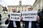Roma 25th feb 2015, leader and parliamentarians of Lega Nord party, demonstrates at Campidoglio's Square, demanding the resignation of mayor of Rome. In the picture some demonstrators hold sign reading ' Marino go Home ' and ' let's evict Marino '