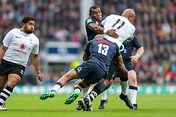 Nemani Nadolo of Fiji is tackled by Semesa Rokoduguni of England and Jonathan Joseph of England - Rogan Thomson/JMP - 19/11/2016 - RUGBY UNION - Twickenham Stadium - London, England - England Rugby v Fiji - Old Mutual Wealth Series.