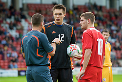 WREXHAM, WALES - Wednesday, August 20, 2008: Wales' Ched Evans and Romania's goalkeeper Cristian Tatarusanu are spoken to by referee Firat Aydinus during the UEFA Under 21 European Championship Qualifying Group 10 match at the Racecourse Ground. (Photo by David Rawcliffe/Propaganda)