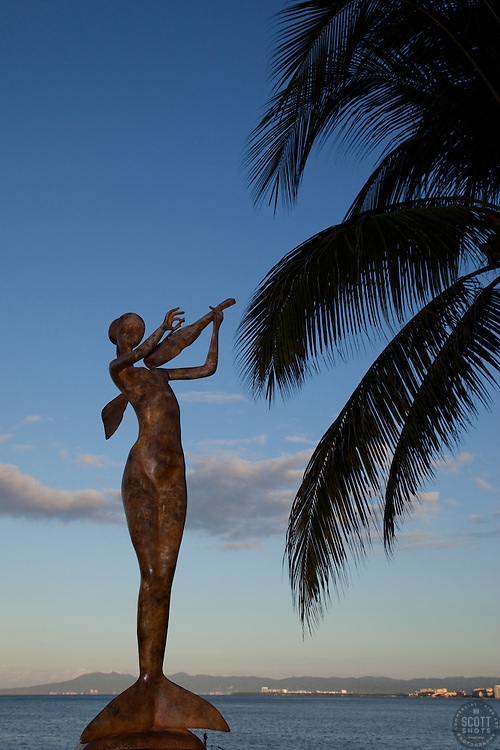 """Mermaid Violinist"" - This violin playing mermaid statue was photographed in Puerto Vallarta, Mexico."