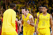 ANN ARBOR, MI - FEBRUARY 5: Nik Stauskas #11 of the Michigan Wolverines celebrates against the Ohio State Buckeyes during the game at Crisler Center in Ann Arbor, Michigan on February 5. Michigan won 76-74. (Photo by Joe Robbins)