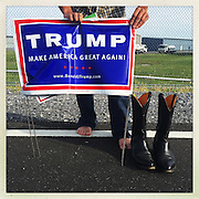Long day and his new boots are killing him.<br /> <br /> Republican presidential candidate Donald Trump is in town for a rally. Hundreds are turned away from the full venue. They linger outside mingling with supporters, counter-demonstrators and vendors.