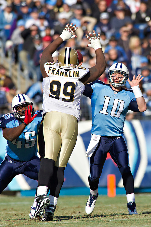 NASHVILLE, TN - DECEMBER 11:   Jake Locker #10 of the Tennessee Titans throws a pass over Aubrayo Franklin #99 of the New Orleans Saints at LP Field on December 11, 2011 in Nashville, Tennessee.  The Saints defeated the Titans 22-17.  (Photo by Wesley Hitt/Getty Images) *** Local Caption *** Jake Locker; Aubrayo Franklin