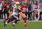 Los Angeles Chargers running back Troymaine Pope (35) runs with the ball while San Francisco 49ers cornerback Quinten Rollins (30) runs after, during an NFL football game, Thursday, Aug. 29, 2019, in Santa Clara, Calif. (Dylan Stewart/Image of Sport)